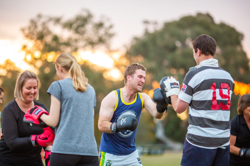 female and male farmers boxing to keep fit